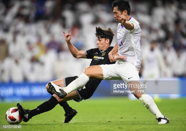 Jack-Henry Sinclair of Team Wellington and Tsukasa Shiotani of Al Ain battle for the ball during the FIFA Club World Cup first round play-off match...