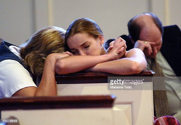 Jacki Curry holds her daughter Jessica Curry during a prayer vigil at Poplar Springs Drive Baptist Church for missing teen Natalie Holloway who...