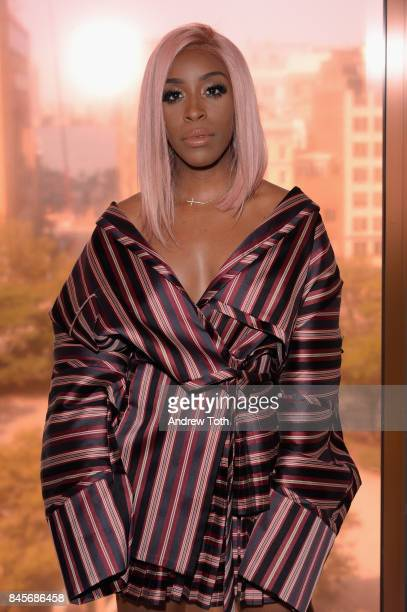 Jackie Aina attends Zimmermann fashion show during New York Fashion Week The Shows at Spring Studios on September 11 2017 in New York City