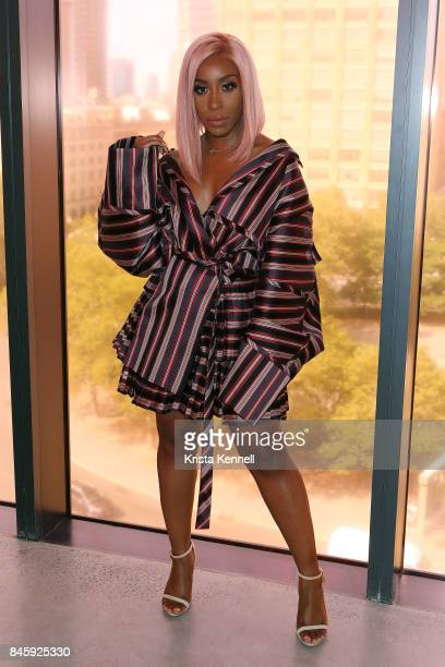 Jackie Aina poses at the Zimmermann show during New York Fashion week at Spring Studios on September 11 2017 in New York City