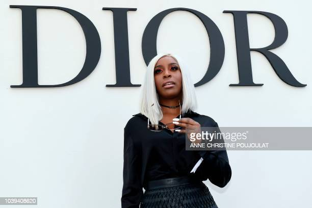 Jackie Aina poses during the photocall prior to the Christian Dior's SpringSummer 2019 ReadytoWear collection fashion show in Paris on September 24...