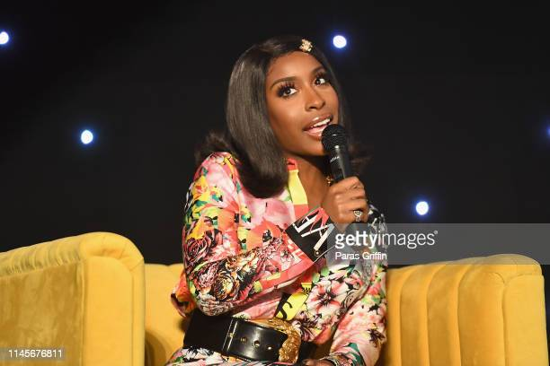 Jackie Aina speaks on stage during the 2019 ESSENCE Beauty Carnival Day 2 on April 28 2019 in New York City