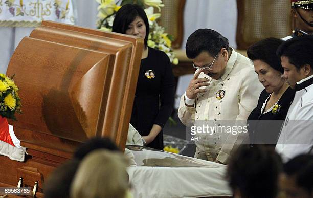Jackie Aquino the niece of the late Philippine president Corazon Aquino looks on as another former Philippine president Joseph Estrada pays his last...