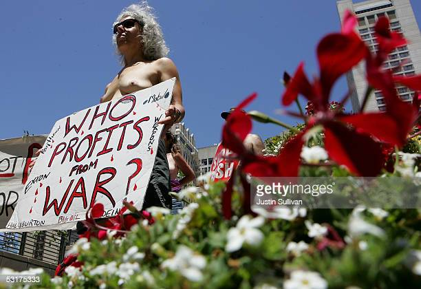 Jackie Barshak of San Rafael California bares her breasts and holds a sign against the war in Iraq in Union Square park June 30 2005 in San Francisco...