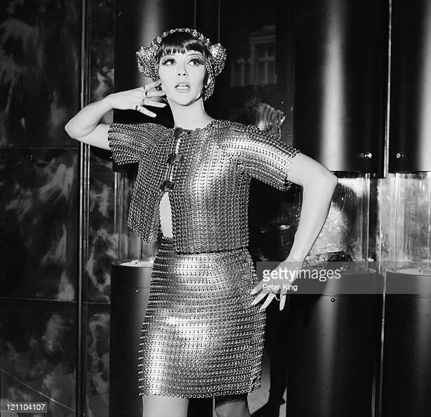 Jackie Bowyer wears a silver chainmail bolero with matching miniskirt by Paco Rabanne, 7th November 1967. She is modelling it at the opening of the...