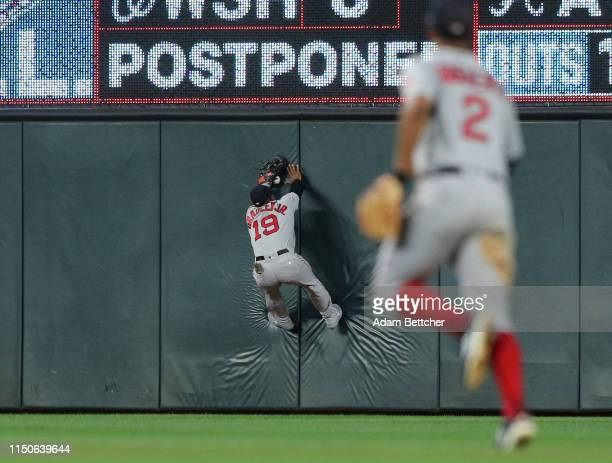 Jackie Bradley Jr #18 of the Boston Red Sox makes a catch off of the outfield wall in the seventh inning against the Minnesota Twins at Target Field...