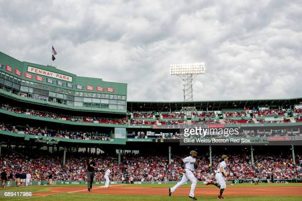 Jackie Bradley Jr #19 and Andrew Benintendi of the Boston Red Sox run onto the field before a game against the Seattle Mariners on May 28 2017 at...