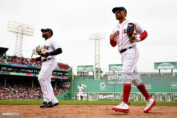 Jackie Bradley Jr #19 and Mookie Betts of the Boston Red Sox head to the dugout in between innings during a game against the Baltimore Orioles at...