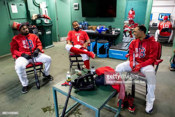 Jackie Bradley Jr #19 Chris Young and Mookie Betts of the Boston Red Sox sit in the batting cage before a game against the Tampa Bay Rays on May 12...