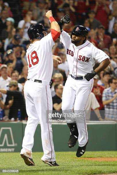 Jackie Bradley Jr #19 high fives Mitch Moreland of the Boston Red Sox after hitting a three run homerun in the eighth inning of a game against the...