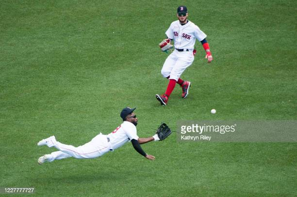 Jackie Bradley Jr #19 makes a leaping catch while teammate Alex Verdugo of the Boston Red Sox looks on in the fourth inning against the Baltimore...