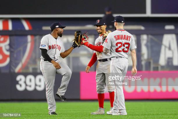 Jackie Bradley Jr #19 Mookie Betts and Blake Swihart of the Boston Red Sox celebrate after the Red Sox beat the New York Yankees in Game 3 of the...
