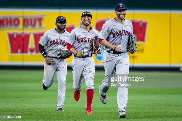 Jackie Bradley Jr #19 Mookie Betts and JD Martinez of the Boston Red Sox celebrate after the game at Oriole Park at Camden Yards on August 12 2018 in...