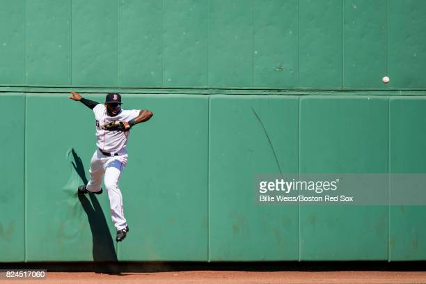 Jackie Bradley Jr #19 of the Boston Red Sox attempts to catch a line drive off of the wall during the sixth inning of a game against the Kansas City...
