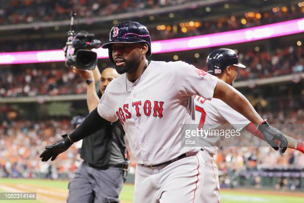 Jackie Bradley Jr #19 of the Boston Red Sox celebrates after hitting a grand slam home run in the eighth inning against the Houston Astros during...