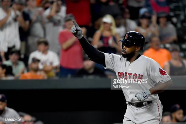 Jackie Bradley Jr #19 of the Boston Red Sox celebrates after hitting a threerun home run during the fourth inning against the Baltimore Orioles at...