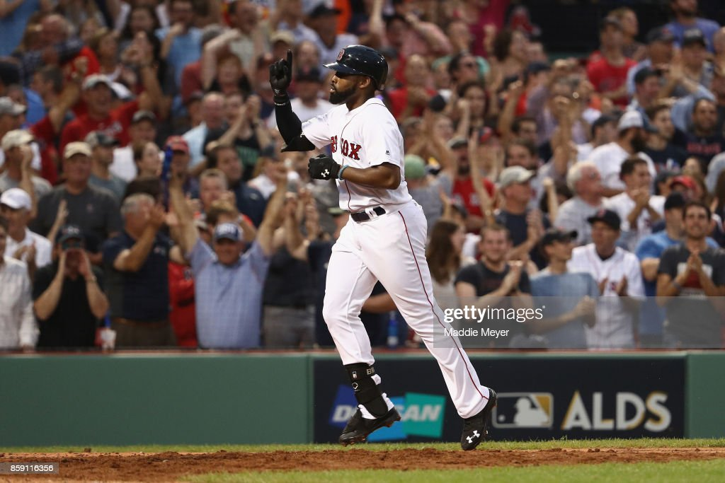 Jackie Bradley Jr. #19 of the Boston Red Sox celebrates after hitting a three-run home run in the seventh inning against the Houston Astros during game three of the American League Division Series at Fenway Park on October 8, 2017 in Boston, Massachusetts.
