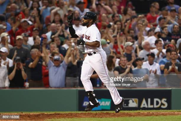 Jackie Bradley Jr #19 of the Boston Red Sox celebrates after hitting a threerun home run in the seventh inning against the Houston Astros during game...