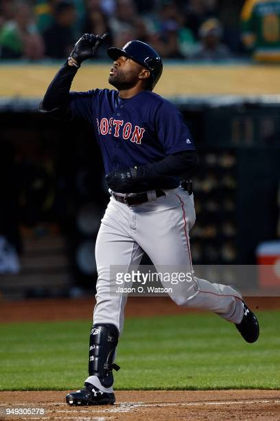 Jackie Bradley Jr #19 of the Boston Red Sox celebrates after hitting a three run home run against the Oakland Athletics during the second inning at...