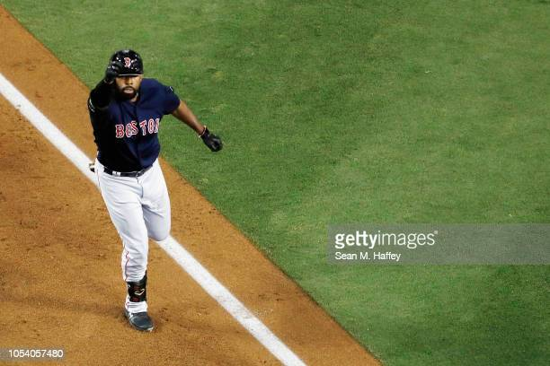 Jackie Bradley Jr #19 of the Boston Red Sox celebrates his eighth inning home run against the Los Angeles Dodgers in Game Three of the 2018 World...