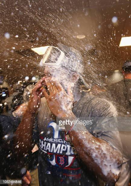 Jackie Bradley Jr #19 of the Boston Red Sox celebrates in the clubhouse after defeating the Houston Astros 41 in Game Five of the American League...