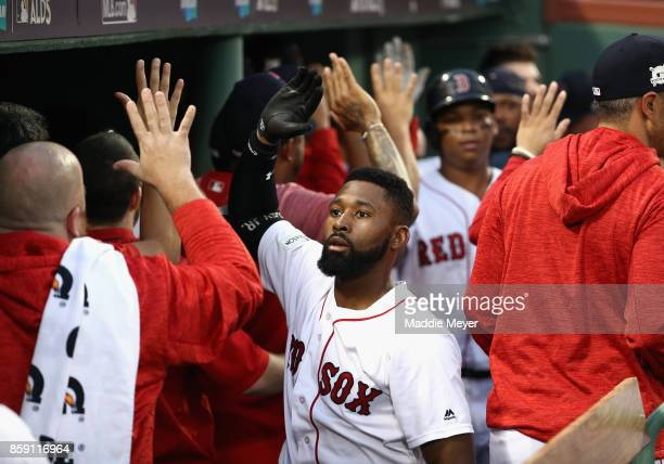 Jackie Bradley Jr #19 of the Boston Red Sox celebrates in the dugout after hitting a threerun home run in the seventh inning against the Houston...