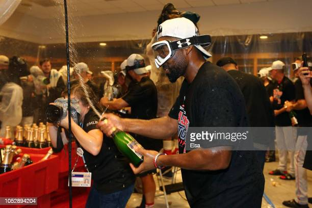 Jackie Bradley Jr #19 of the Boston Red Sox celebrates in the locker room with his team after defeating the New York Yankees to win Game Four...