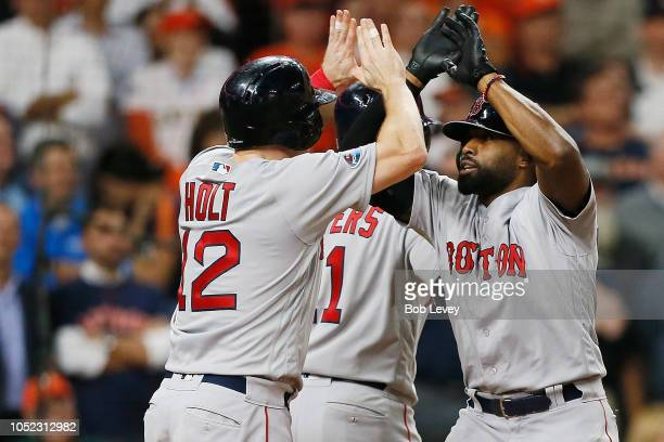 Jackie Bradley Jr #19 of the Boston Red Sox celebrates with Brock Holt after hitting a grand slam home run in the eighth inning against the Houston...