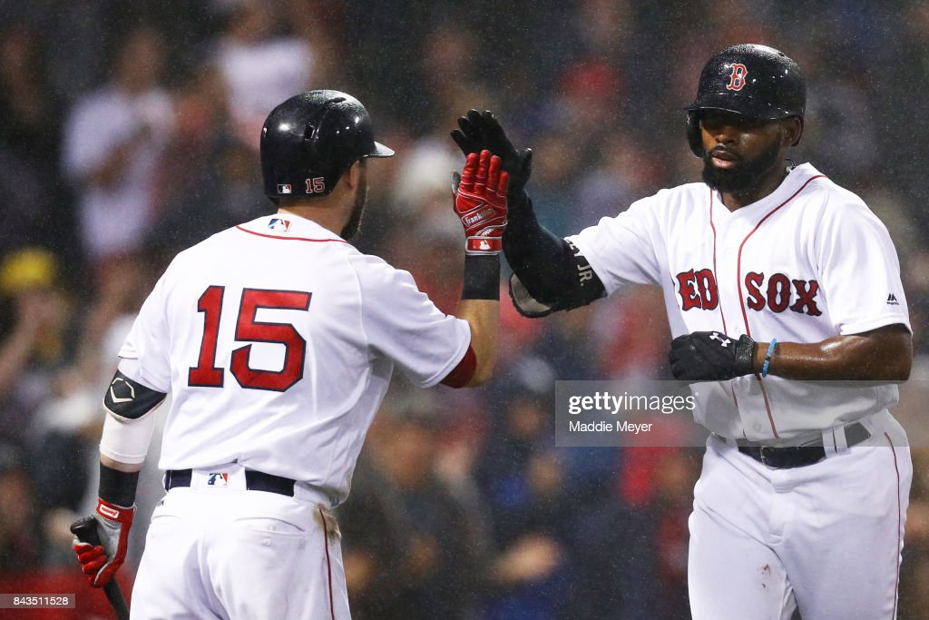 Jackie Bradley Jr. #19 of the Boston Red Sox celebrates with Dustin Pedroia #15 after hitting a two run home run against the Toronto Blue Jays during the fourth inning at Fenway Park on September 6, 2017 in Boston, Massachusetts.