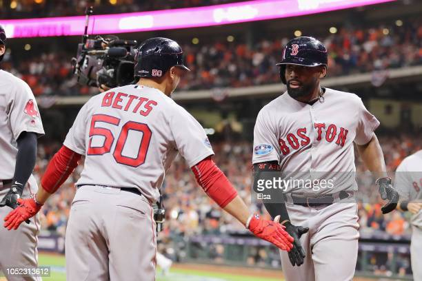Jackie Bradley Jr #19 of the Boston Red Sox celebrates with Mookie Betts after hitting a grand slam home run in the eighth inning against the Houston...