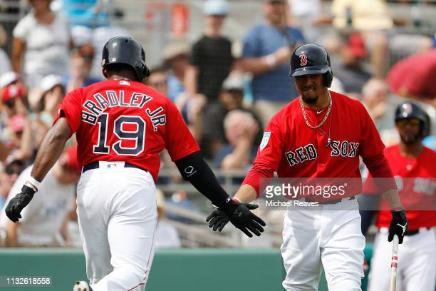 Jackie Bradley Jr #19 of the Boston Red Sox celebrates with Mookie Betts after hitting a solo home run in the first inning against the Baltimore...