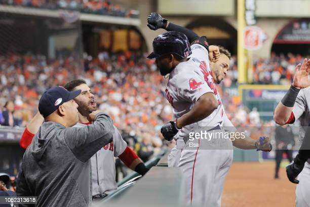 Jackie Bradley Jr #19 of the Boston Red Sox celebrates with Xander Bogaerts at the dugout after hitting a grand slam home run in the eighth inning...