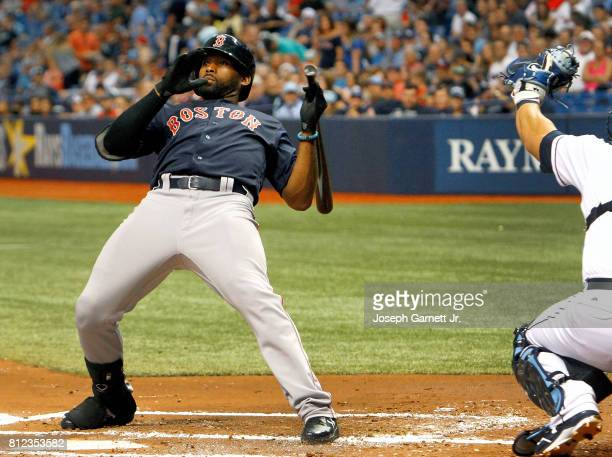 Jackie Bradley Jr #19 of the Boston Red Sox dodges a pitch during the second inning of the game against the Tampa Bay Rays at Tropicana Field on July...