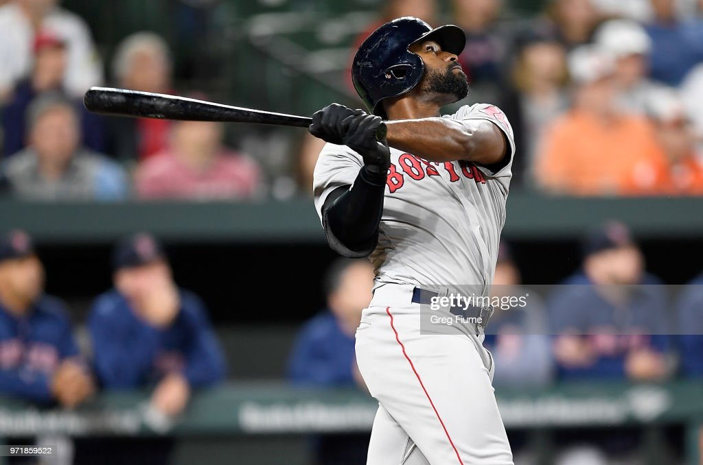 Jackie Bradley Jr. #19 of the Boston Red Sox drives in a run with a sacrifice fly in the 12th inning against the Baltimore Orioles at Oriole Park at Camden Yards on June 11, 2018 in Baltimore, Maryland.