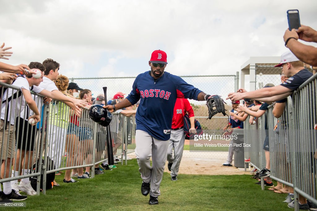 Jackie Bradley Jr. #19 of the Boston Red Sox high fives fans during a team workout on February 21, 2018 at jetBlue Park at Fenway South in Fort Myers, Florida .