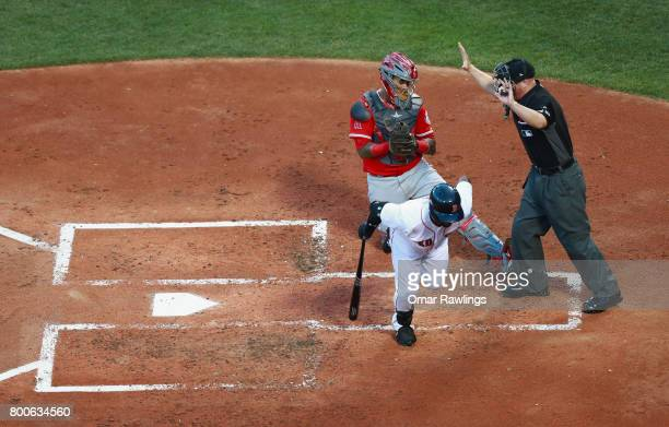 Jackie Bradley Jr #19 of the Boston Red Sox hit by a pitch in the second inning of the game against the Los Angeles Angels at Fenway Park on June 24...
