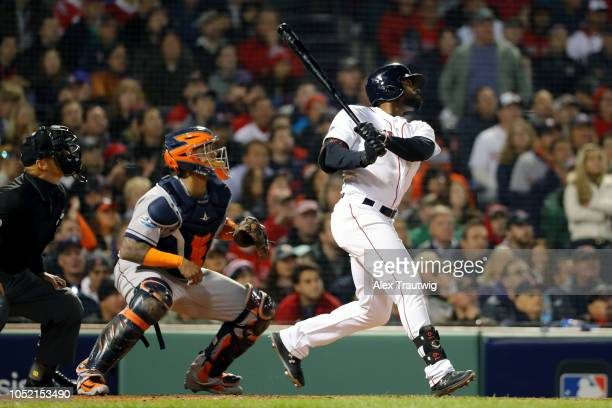 Jackie Bradley Jr #19 of the Boston Red Sox hits a bases clearing double in the third inning during Game 2 of the ALCS against the Houston Astros at...