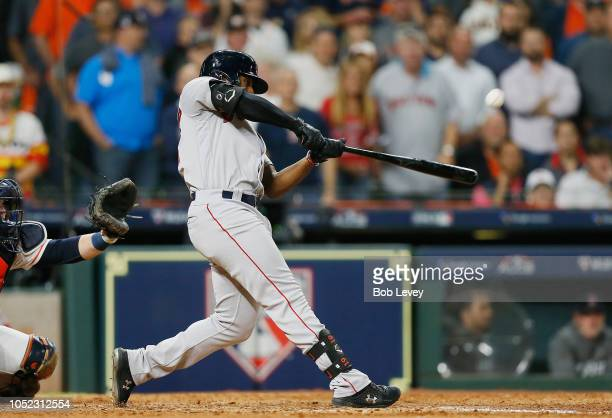 Jackie Bradley Jr #19 of the Boston Red Sox hits a grand slam home run in the eighth inning against the Houston Astros during Game Three of the...