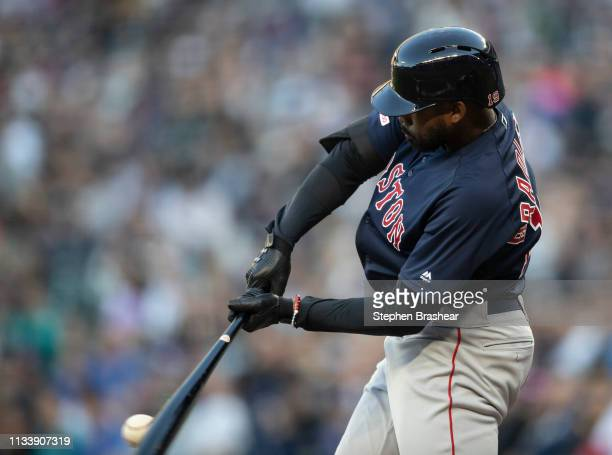 Jackie Bradley Jr #19 of the Boston Red Sox hits a RBIsingle off of starting pitcher Mike Leake of the Seattle Mariners to score Mitch Moreland of...