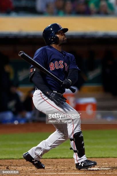 Jackie Bradley Jr #19 of the Boston Red Sox hits a three run home run against the Oakland Athletics during the second inning at the Oakland Coliseum...