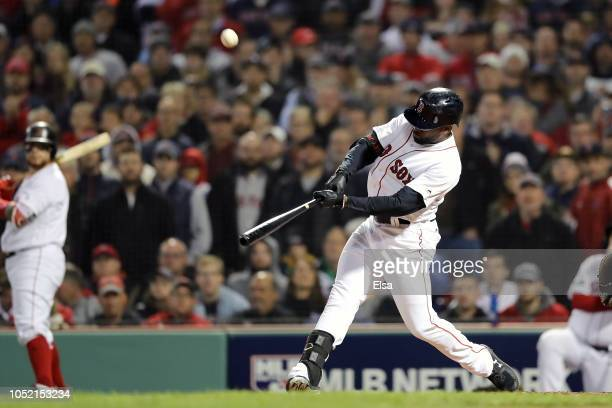 Jackie Bradley Jr #19 of the Boston Red Sox hits a threerun double during the third inning against the Houston Astros in Game Two of the American...