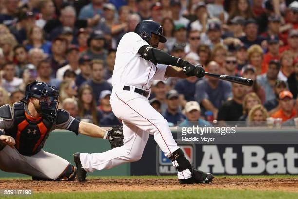 Jackie Bradley Jr #19 of the Boston Red Sox hits a threerun home run in the seventh inning against the Houston Astros during game three of the...