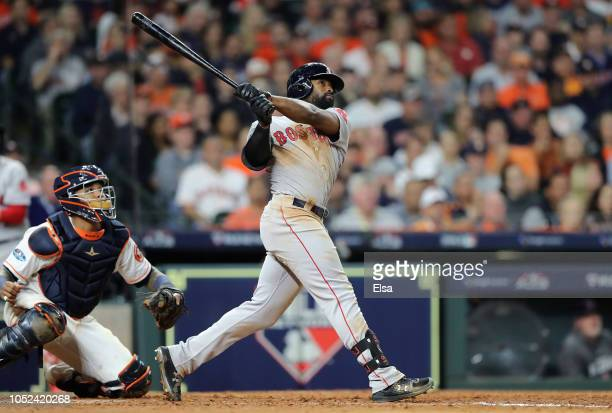 Jackie Bradley Jr #19 of the Boston Red Sox hits a tworun home run in the sixth inning against the Houston Astros during Game Four of the American...