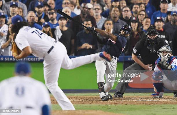Jackie Bradley Jr #19 of the Boston Red Sox hits an eighth inning home run on a pitch from Kenley Jansen of the Los Angeles Dodgers in Game Three of...