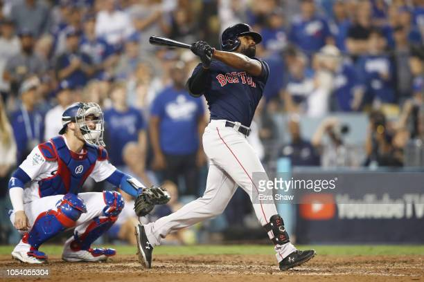 Jackie Bradley Jr #19 of the Boston Red Sox hits an eighth inning home run against the Los Angeles Dodgers in Game Three of the 2018 World Series at...