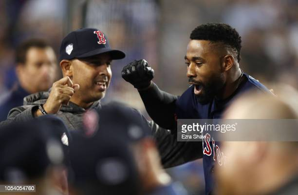 Jackie Bradley Jr #19 of the Boston Red Sox is congratulated by his manager Alex Cora after his eighth inning home run against the Los Angeles...