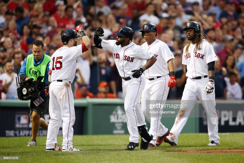 Jackie Bradley Jr. #19 of the Boston Red Sox is greeted by Dustin Pedroia #15 after hitting a three-run home run during Game 3 of the American League Division Series against the Houston Astros at Fenway Park on Sunday, October 8, 2017 in Boston, Massachusetts.