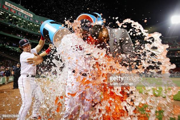 Jackie Bradley Jr #19 of the Boston Red Sox is showered in Powerade while being interviewed by NESN sideline reporter Jahmai Webster after the...