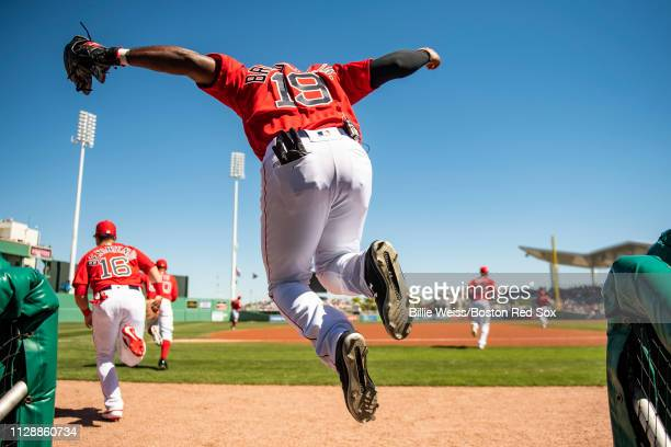 Jackie Bradley Jr #19 of the Boston Red Sox jumps out of the dugout before a game against the Pittsburgh Pirates on March 6 2019 at JetBlue Park at...
