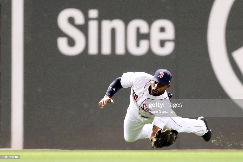 Jackie Bradley Jr. #19 of the Boston Red Sox makes a diving catch in the sixth inning of a game against the Texas Rangers at Fenway Park on July 10, 2018 in Boston, Massachusetts.